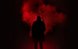 Hooded Figure in Red Smoke Cloud